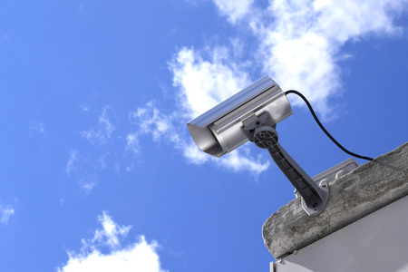 ownership and control: Surveillance Camera on a sky background