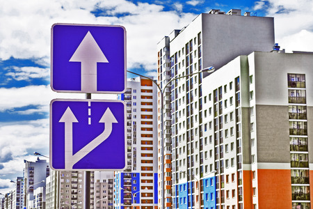 unilateral: Road sign one way traffic in the background of a new residential