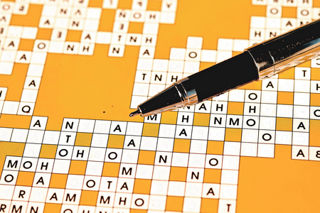ball point: Ball point pen on the background of crossword Stock Photo