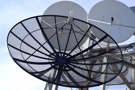 technological and communication: Satellite dish on blue sky background