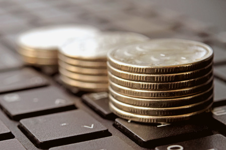 grow money: Coins stacked in bars. The concept of revenue growth