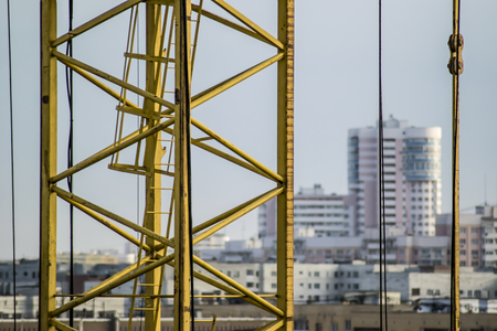 city background: Construction tower crane on the background of the city Stock Photo