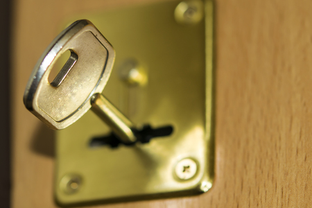 lock and key: The key in the lock of the front door