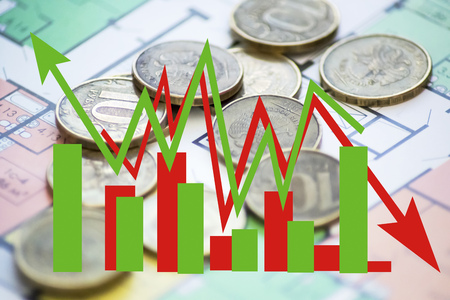 Green and red arrow - graph on a background of money. The concept of changing prices on the market Stock Photo