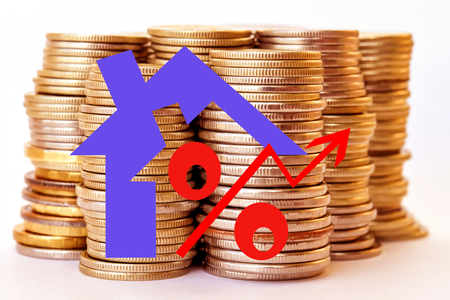 Red icon of interest on the background of coins. The concept of reducing property prices