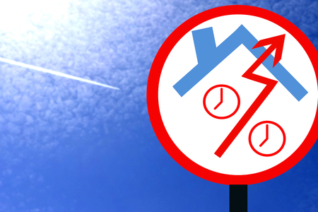 Road sign against the blue sky and clouds. The concept of changes in property prices