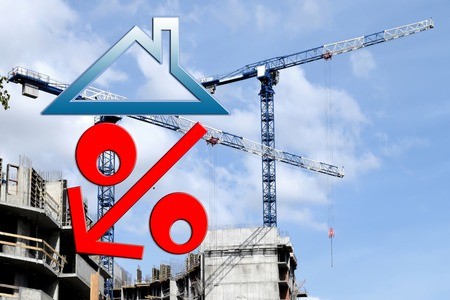 proprietary: Red percent sign on the background of building a house. The concept of price changes on the real estate market.