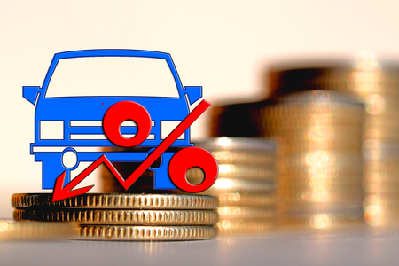 Passenger car and red percent sign on a background of money. The concept of change of car prices