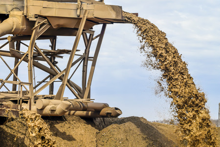 Extraction of mineral resources in a sand quarry. Stock Photo