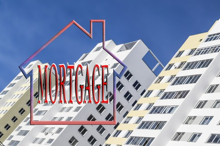 The word mortgage in the background of new homes