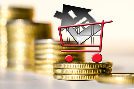Consumer cart and house on a background of money. The concept of mortgage lending.