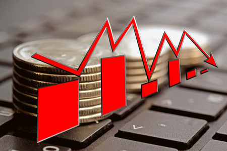 The red arrow on the background of money. The concept of changes in Bank interest rates Stock Photo