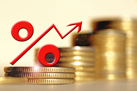 monies: Red percent sign on a background of money. The concept of changes in Bank interest rates.