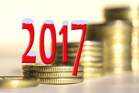 monies: 2017 amid bars coins. The concept of the new fiscal year.