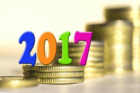 fiscal: 2017 amid bars coins. The concept of the new fiscal year.