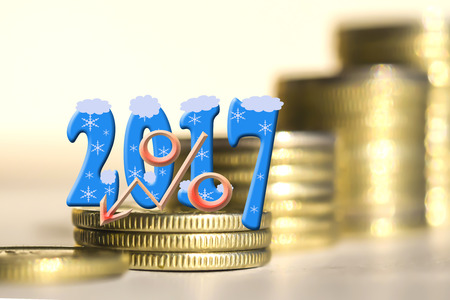 2017 amid bars coins. The concept of the new fiscal year.