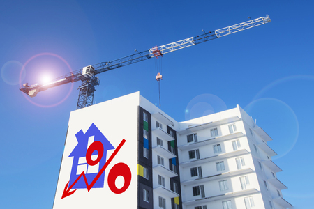 architect drawing: Billboard on the background of building a house. The concept of reducing property prices Stock Photo