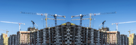 Panorama of the construction of modern concrete buildings