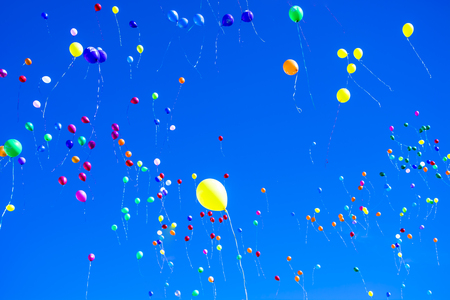 Colorful balloons against a blue sky