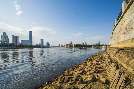 Russia .Ekaterinburg. City pond on the background of Yekaterinburg - city.