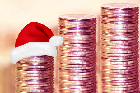 Coins stacked in bars. . The concept of new years discounts and sales.