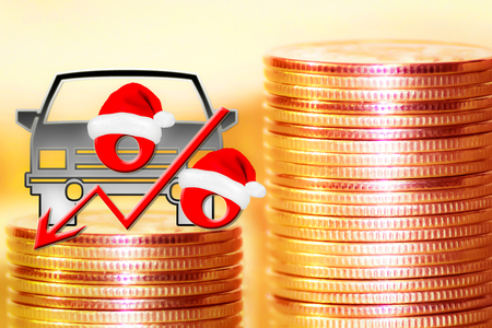 Passenger car and red percent sign on a background of money. The concept of Christmas sales cars. Stok Fotoğraf