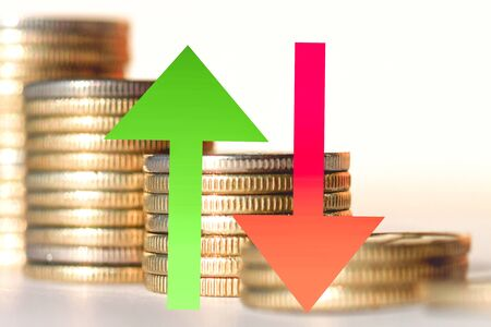 Red and green arrow on the background of money. The concept of changing markets. Stockfoto