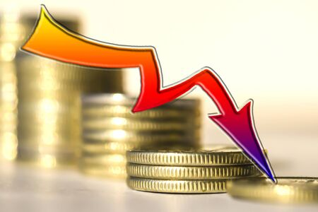 Red arrow on the background of money. The concept of reducing financial indicators. Stockfoto