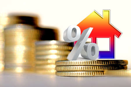 Real estate symbol on a background of white silver coins. The concept of changing investment markets.