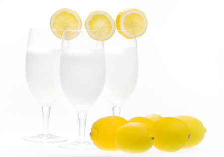 White cocktail drink with lemon
