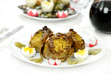 Outline of artichokes cooked with olive oil photo