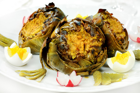 artichoke dish with oil photo