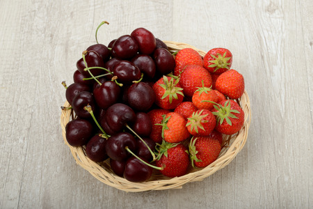 basket of strawberries and cherries photo