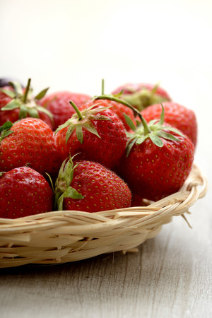 Basket of strawberries on a table photo