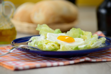 Fried egg with salad photo