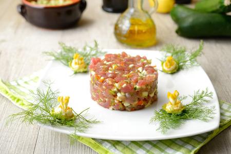 tuna tartare with celery, cucumber and zucchini flowers