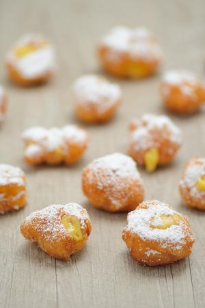 Italian pancakes stuffed with custard on a wooden table