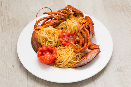 spaghetti with tomato and American lobster photo
