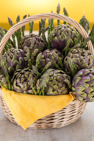 cardunculus scolymus: basket with artichokes and asparagus