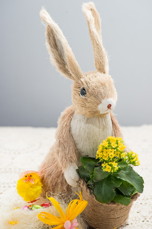 Decorating Easter bunny-shaped photo