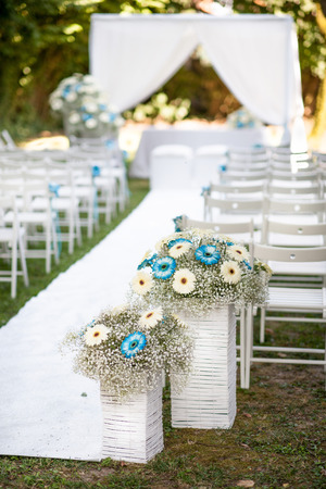decorated with flowers and preparations for an outdoor wedding photo