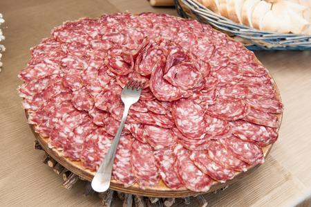 salami sliced on cutting board photo