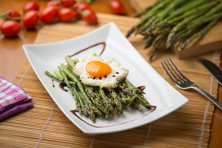 plate of asparagus baked with egg steam