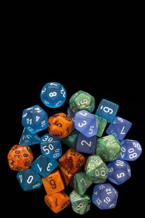 4 RPG sets orange / blue / green for playing role playing games on black background.