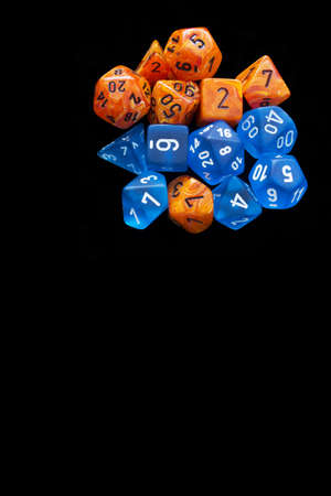 RPG sets orange / blue for playing role playing games on black background. Stock Photo