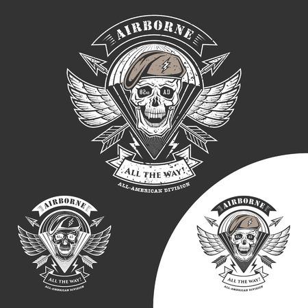 tete de mort: Emblème Airborne avec crâne, des flèches, des ailes et parachute.