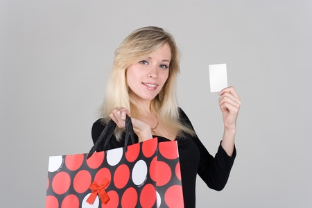blondie: Young girl with bag confidence shows a blank plastic card