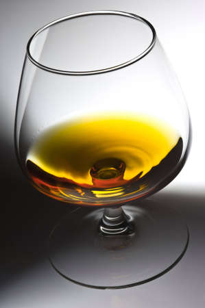 Glass with alcohol on a light background