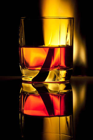 reflexion: Glass with alcohol against fire with reflexion