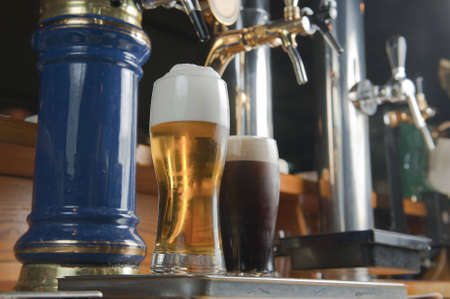 handle bars: beers, alcohol, drinks, pub, bar, foam, froth, glass, cold, on, drop, refreshment, ale, isolated, beverage, lager, pint, yellow, party, white, tap, full, mug, objects, hour, chrome, liquid, nb, refresh, orange, celebration, light, barstool, one, handle, r